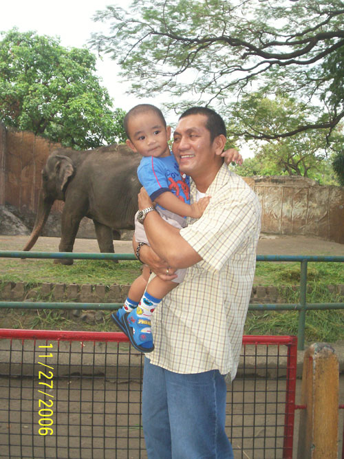 sean and daddy at the zoo last year