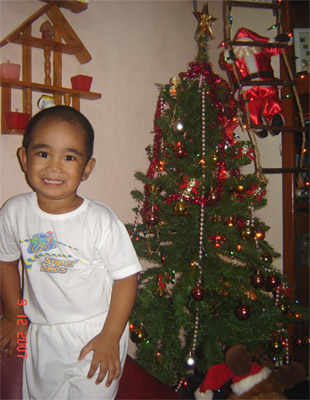 Sean beside our Christmas Tree